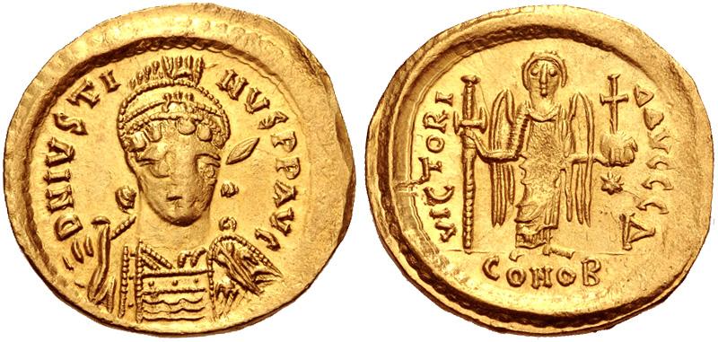 Solido di Giustino I (518-527) con al rovescio raffigurazione frontale di una Vittoria ormai trasformata in un angelo (oro, g 4,40; mm 20; h 6)
