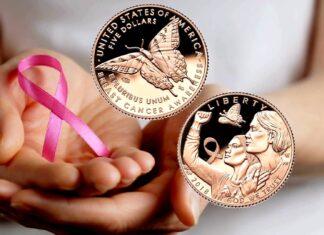 Tre monete a stelle e strisce sotto il segno del nastro rosa