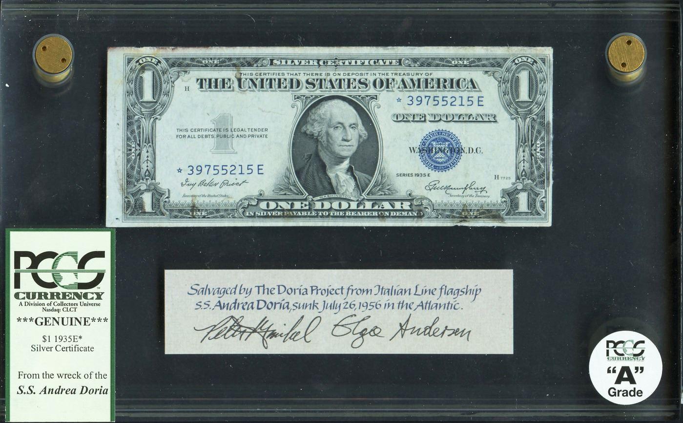 """Memoria numismatica di un naufragio: uno dei dollari recuperati dalla cassaforte della """"Andrea Doria"""" naufragata nell'Altantico nel 1956"""