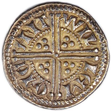 Una grande croce accantonata da tre globetti per quadrante su questa moneta eccezionale battuta a Canterbury