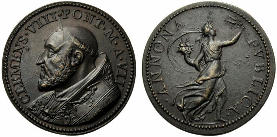 Il grande incisore Gian Cristoforo Romano realizza per Clemente VIII un'Annona danzante ed elegantissima per questa medaglia in bronzo (mm 33)