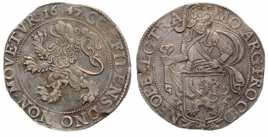 """Il """"tallero del leone"""" in argento, una delle monete olandesi più diffuse. Qui un esemplare coniato ad Utrecht nel 1647 (mm 41,5 per g 27,1)"""