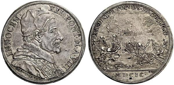 La piastra in argento (mm 43) del 1699 con al rovescio la biblica scena della raccolta della manna ispirata all'omonimo dipinto di Poussin