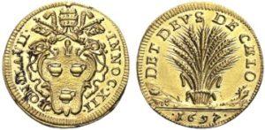 Raro scudo in oro (mm 23) del 1697 di papa Pignatelli con al rovescio un bellissimo fascio di spighe di grano