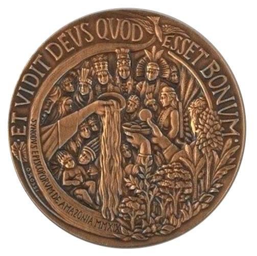 La medaglia papale annuale 2019, rovescio: i Sacramenti e il messaggio del Vangelo come linfa vitale nel rispetto delle comunità indigene