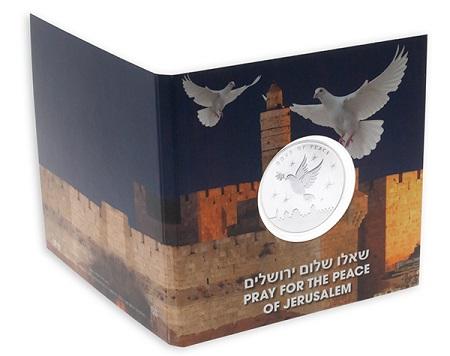 Le mura di Gerusalemme e un volo di colombe per l'esterno del blister di questa nuova oncia bullion dello Stato di Israele