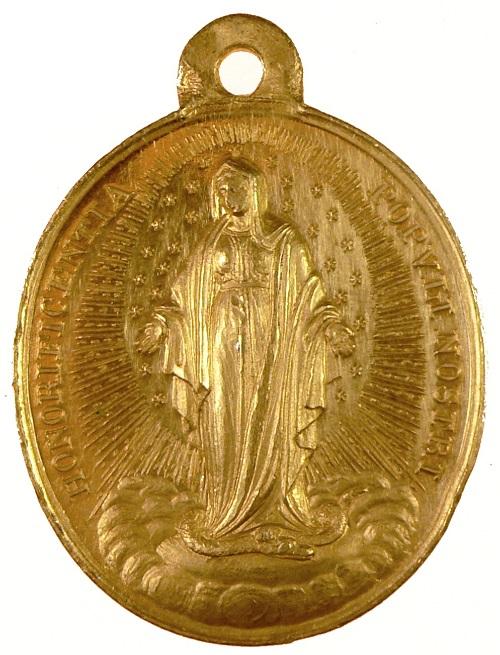 Il raffinato dritto della medaglia in onore dell'Immacolata coniata con l'oro australiano su coni di Bonfilio Zaccagnini