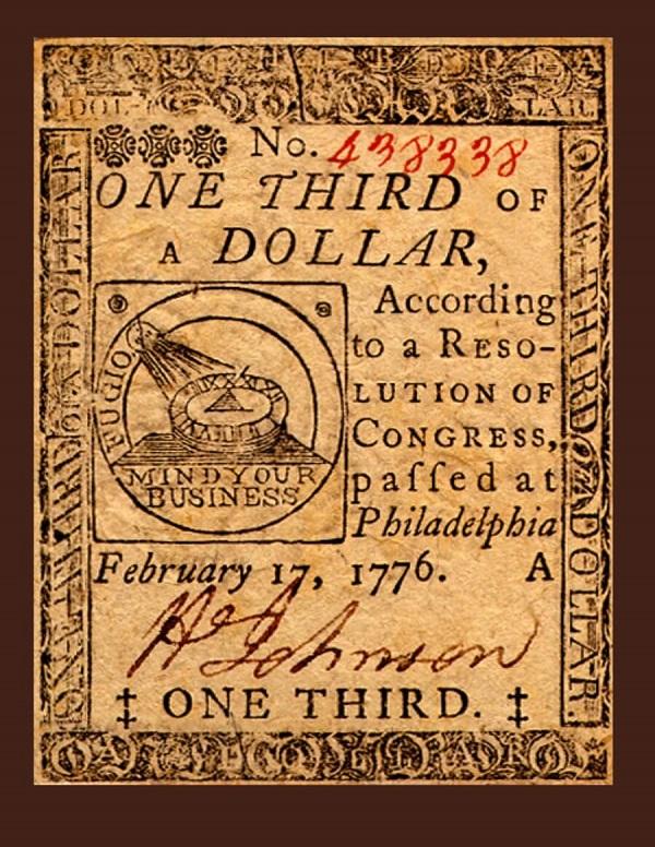 """Biglietto da 1/3 di dollaro stampato nel 1776 e recante la stessa iconografia del """"Fugio cent"""": il sole, la meridiana e le legende FUGIO e MIND YOUR BUSINESS"""