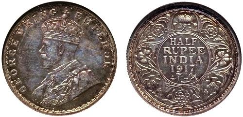 Moneta in argento da una rupia per la colonia dell'India Britannica coniata al peso di 11,66 grammi per 30,50 millimetri di diametro, con effigie dell'imperatore Giorgio V