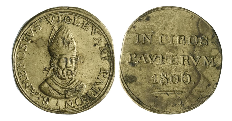 Un bel gettone caritativo utilizzato come buono pasto dagli istituti per i poveri, risalente al 1806 e usato a Vigevano (ottone, mm 28,7)