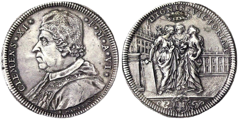 """Un magnifico esemplare del testone in argento dell'anno VI con un formidabile ritratto e tre figuri muliebri di fronte ai palazzi del Campidoglio; il motto recita """"La vittoria ai meritevoli"""""""