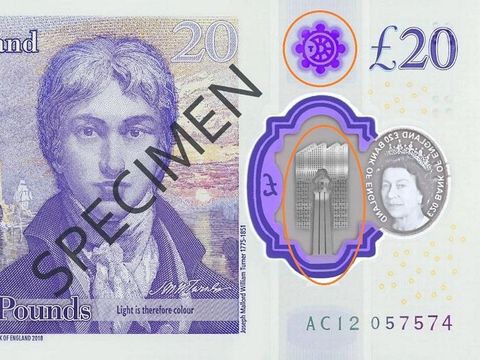 """Dettaglio del fronte delle nuove 20 sterline inglesi dedicate a Turner: in evidenza i due sibmoli """"misteriosi"""" che hanno acceso la fantasia dei complottisti i quali li hanno collegati a coronavirus e 5G"""