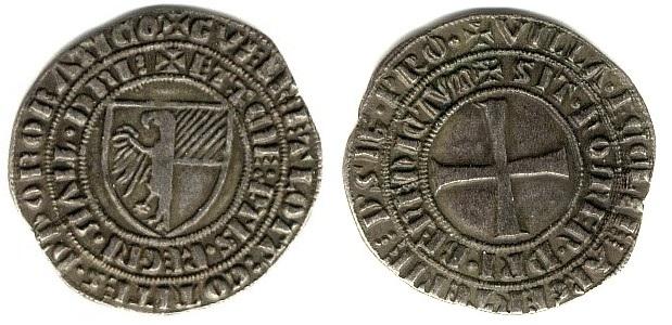 Grosso tornese con stemma dei Donoratico coniato a Villa di Chiesa alla fine del XIII secolo: in una strana lega di argento e piombo, riprendono il famoso tipo monetale francese creato da Luigi IX il Santo