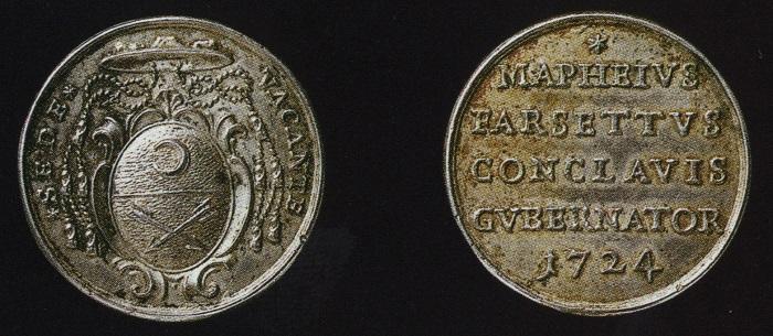 La prima versione della medaglia del Farsetti con refuso di legenda e araldico...