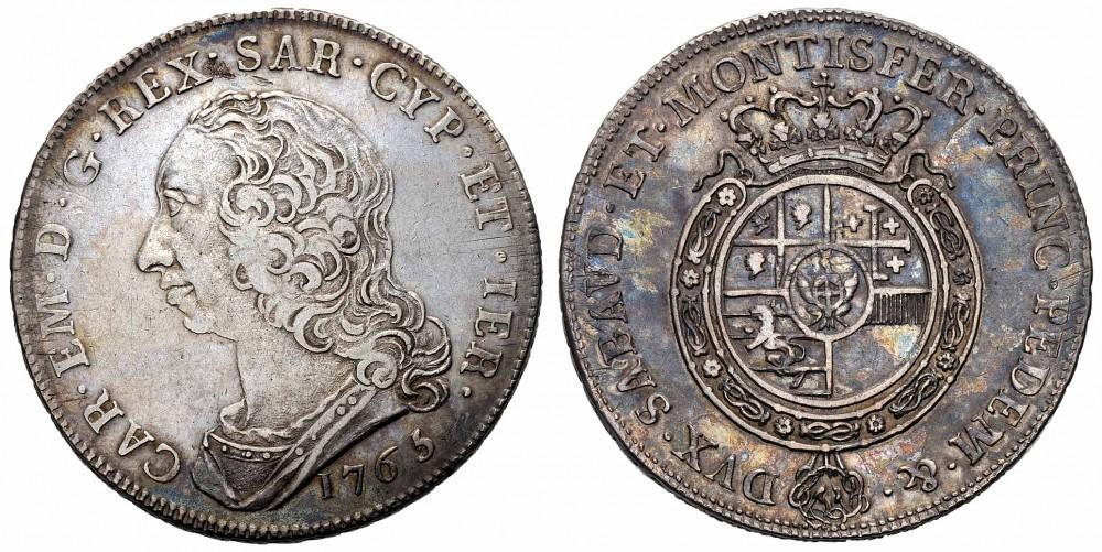 Sullo scudo d'argento da 6 lire piemontesi lo stemma coronato al rovescio è quello che, circondato dal collare dell'Annunziata, assomma in sè tutti gli stemmi dei possedimenti sabaudi