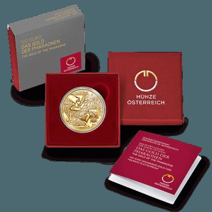 """Sempre curato, il packaging delle monete austriache anche in questo caso, con i colori grigio e rosso, esalta la moneta d'oro da 100 euro proof della serie """"Magic of Gold"""""""