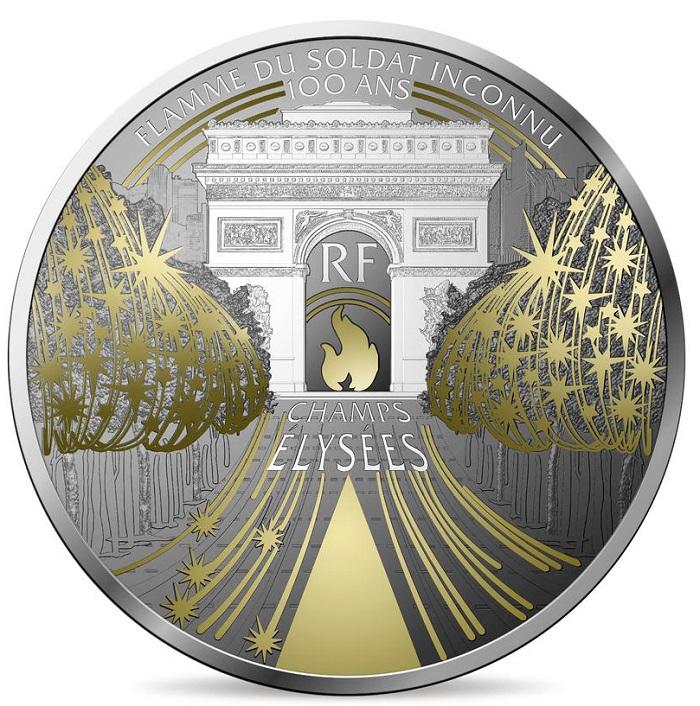 Argento con ossidazioni selettive e applicazioni in oro per rendere in moneta la fiamma del Milite ignoto e le luci di Natale degli Champs Elysées
