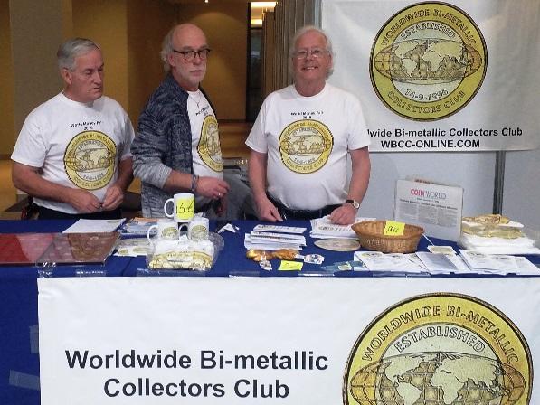 Il tavolo del WBCC ad una delle edizioni della World Money Fair: Martin Peeters, come sempre sorridente, è quello a destra