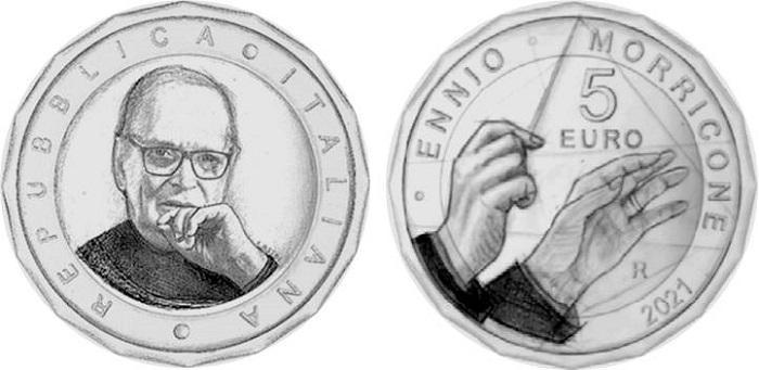 La moneta per Ennio Morricone avrà due versioni, quella in argento fior di conio e questa, poligonale e bimetallica, con finitura proof. Entrambe con nominale di 5 euro, sono firmate da Maria Angela Cassol