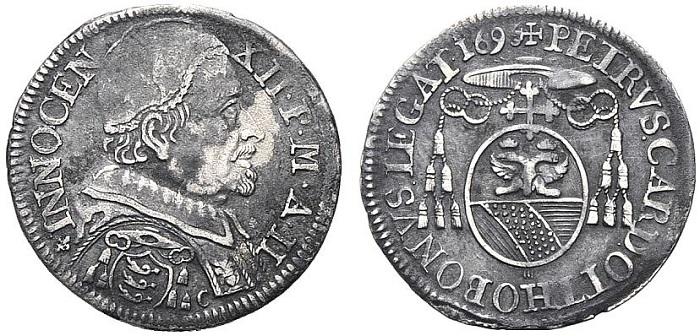 Il primo tipo di dodicesimo di scudo per Avignone, con ritratto di papa Pignatelli avente sulla spalla lo stemma Dolfin e al rovescio l'emblema e il nome del legato, il cardinale Pietro Ottoboni
