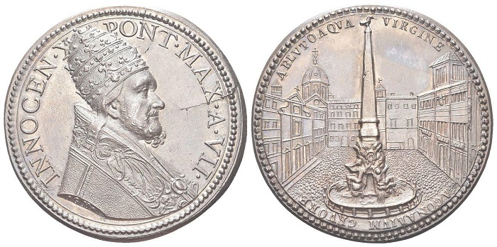 Nel trittico di coniazioni dedicate alla fontana di piazza Navona, questa dell'anno VII è la più riuscita, con il papa in paramenti solenni, il triregno sul capo, e i nitidi dettagli architettonici al rovescio
