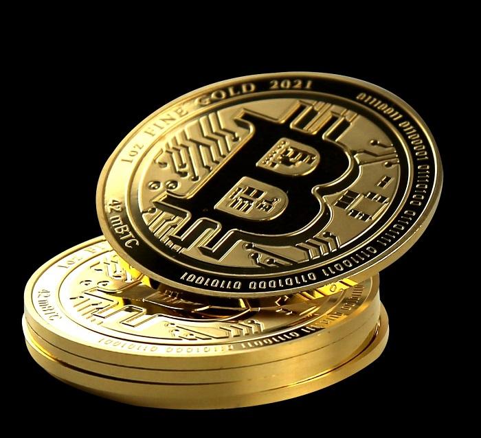 """Il """"Gold Bitcoin"""" in oro da un'oncia emesso a nome di Niue Islands e con nominale di 100 dollari neozelandesi"""