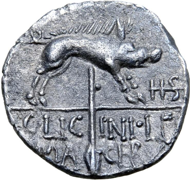 Il rovescio con il segno di valofe della IIS barrata e l'insegna legionaria con all'estremità un cinghiale; in esergo il nome del magistrato