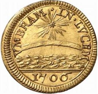 """Il dritto della """"moneta rebus"""" di papa Albani con gli elementi posti """"in capo"""" allo stemma del pontefice"""